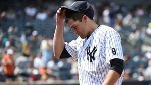 New York Yankees starting pitcher Nathan Eovaldi walks