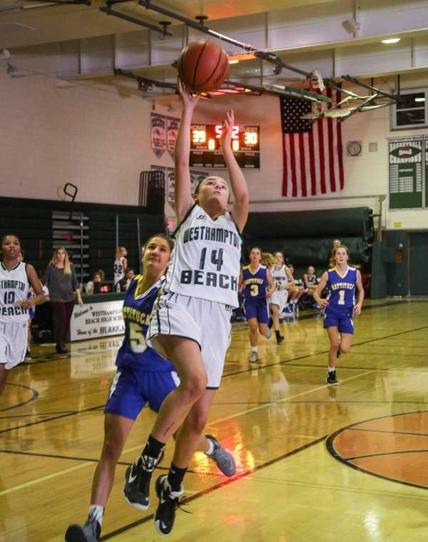 Westhampton Beach's Isabelle Smith (14) goes up for