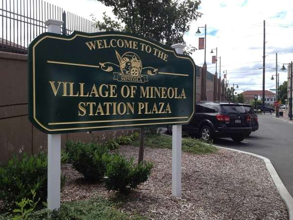 The sign for the Mineola Station Plaza in
