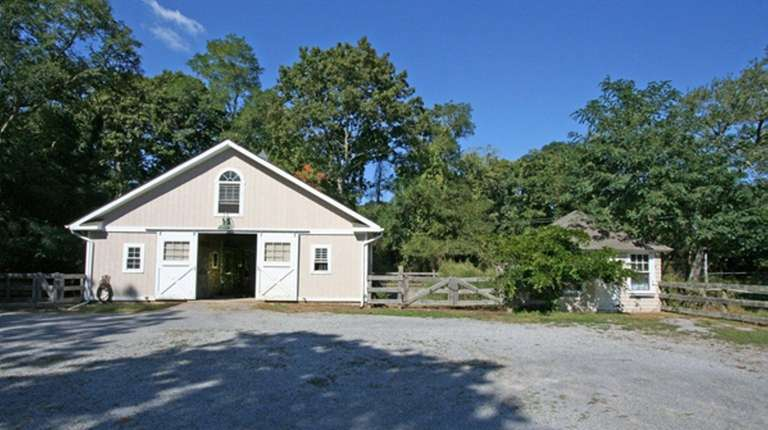 The three-stall barn on this 2.41-acre Mastic Beach