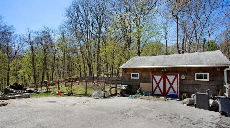 This Oyster Bay property with a barn is