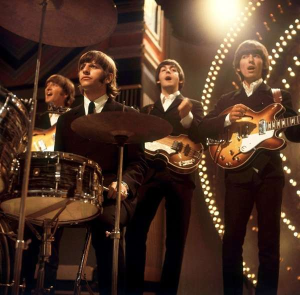 The Beatles, pictured performing in June 1966, will