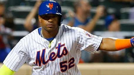 Yoenis Cespedes of the New York Mets reacts