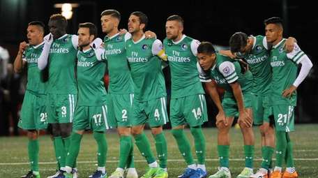 Members of the New York Cosmos get ready