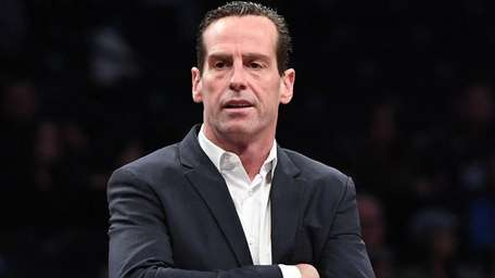 Nets coach Kenny Atkinson looks on against the