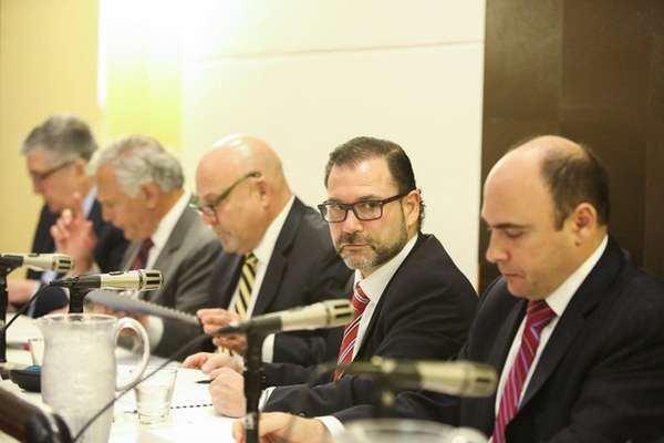 Adam Barsky, second from right, chairman of the