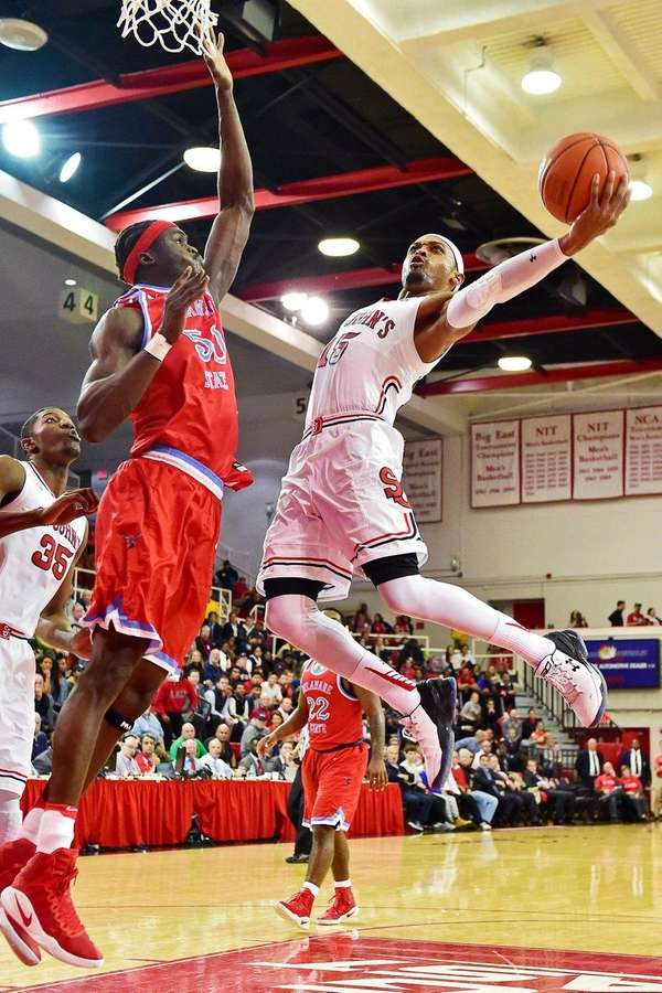 The Red Storm's Marcus LoVett (13 points) attempts