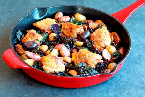 Boneless chicken thighs, baby potatoes and chard make