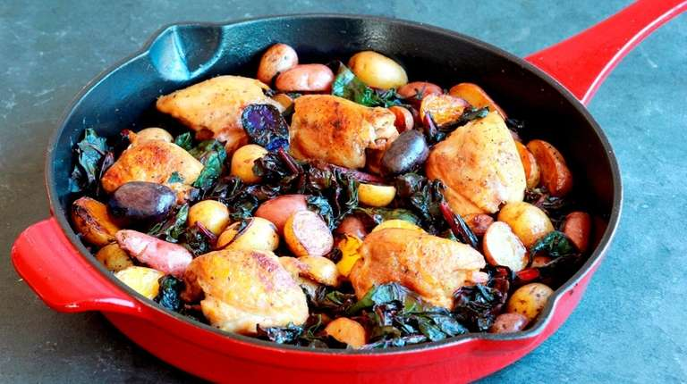 Boneless chicken thighs, baby potatoes and chard make