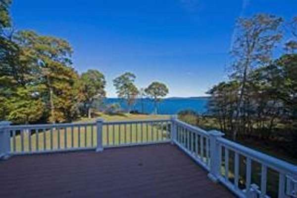 A back deck offers a view of Long