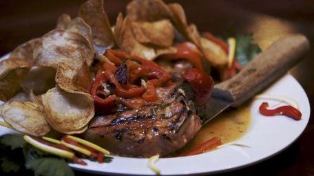 Pork chops alla Carnival are served at Carnival