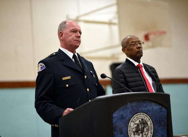 Hempstead Village Police Chief Michael McGowan, left, and