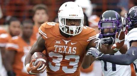 Texas running back D'Onta Foreman is pursued by