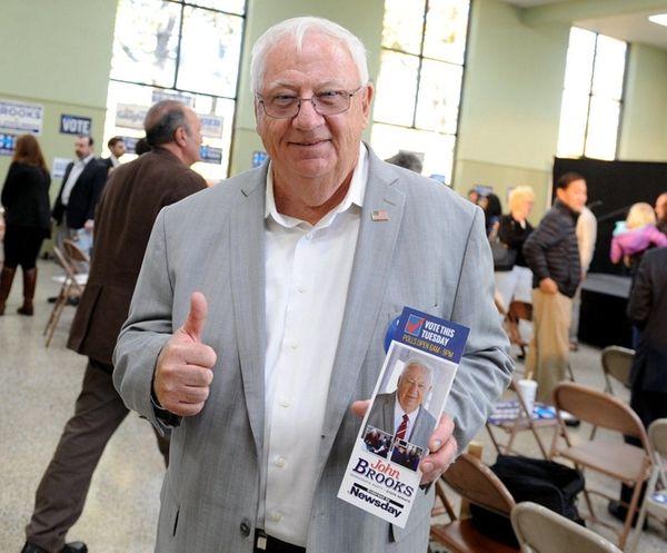 Democrat John Brooks emerged Wednesday with a narrow