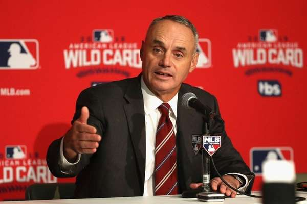 Major League Baseball Commissioner Rob Manfred addresses the