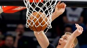 New York Knicks' Kristaps Porzingis of Latvia dunks