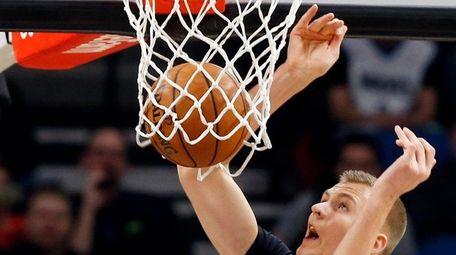 New York Knicks' Kristaps Porzingis of Latvia dunks