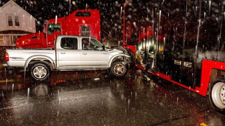 A tractor trailer and a pickup truck collided