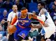 Carmelo Anthony drives past Andrew Wiggins of the