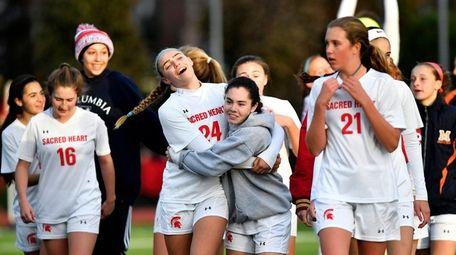 The Sacred Heart girls soccer team celebrates its
