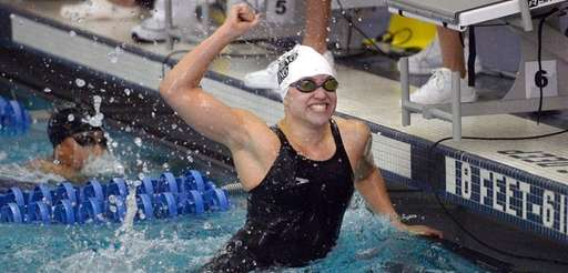 Maggie Aroesty celebrates her state record win in