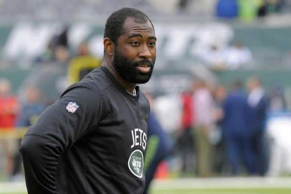 Jets cornerback Darrelle Revis warms up before an
