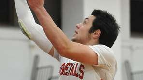 Kyle Acquavella of MacArthur drives to the hoop