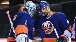 New York Islanders defenseman Dennis Seidenberg congratulates Islanders