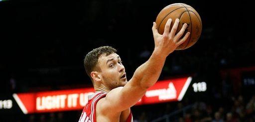 Houston Rockets forward Donatas Motiejunas grabs a rebound