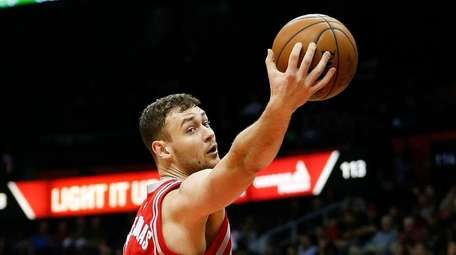 Houston Rockets forward Donatas Motiejunas grabs a rebound
