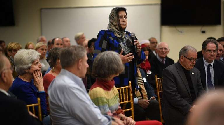 Isma Chaudhry, standing, president of the Islamic Center