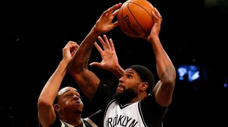 Trevor Booker of the Nets goes to the