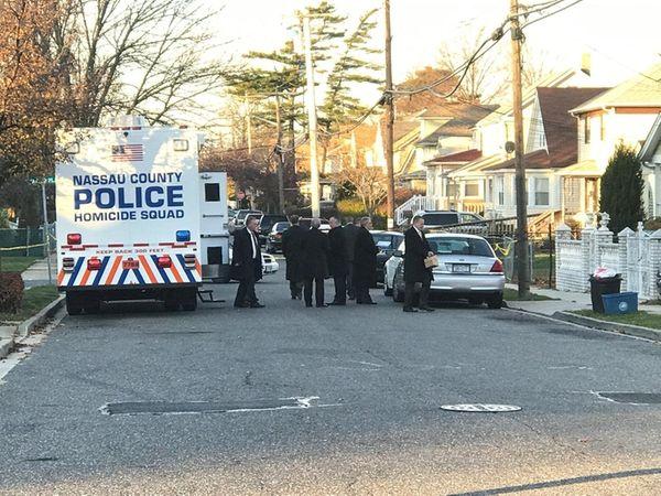 Homicide detectives investigate an area on Elizabeth Avenue