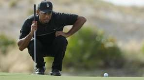 Tiger Woods hits his third shot on the