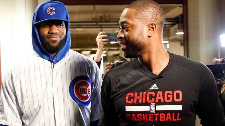 Cleveland Cavaliers' LeBron James talks with Chicago Bulls'