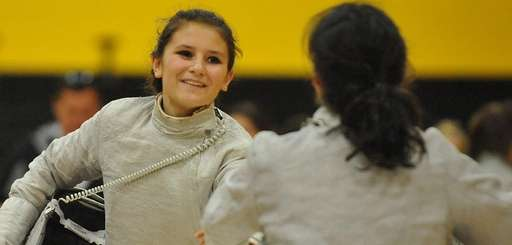 Stephanie Miller of Commack, left, shakes hands with