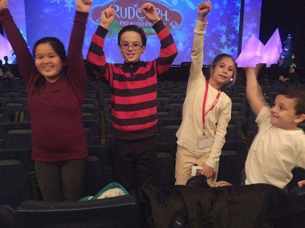 Kidsday reporters, from left, Sydney Quan, Christopher Blake,