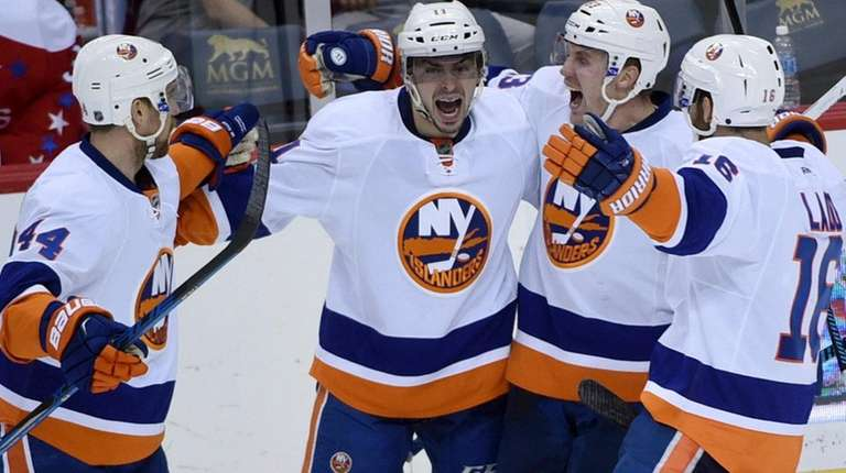 New York Islanders' center Shane Prince (11) celebrates