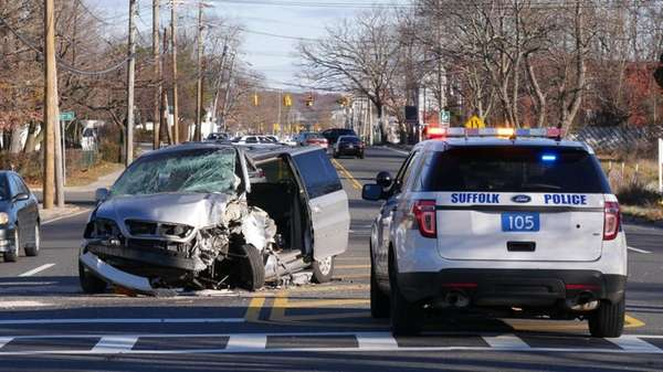 Suffolk County police investigate a one-vehicle crash in