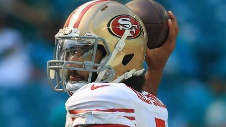 Colin Kaepernick threw for 296 yards and three