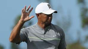 Tiger Woods of the United States waves after