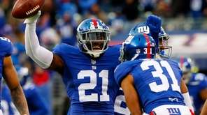 Landon Collins celebrates his interception with teammate Trevin