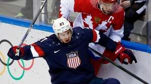USA defenseman Ryan McDonagh collides with Russia forward