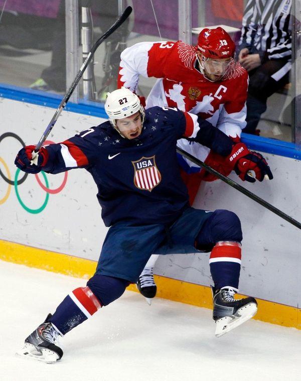 USA defenseman Ryan McDonagh collides with Russia forward