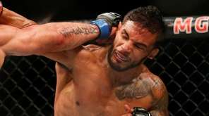 Jeremy Stephens, left, fights Dennis Bermudez during their