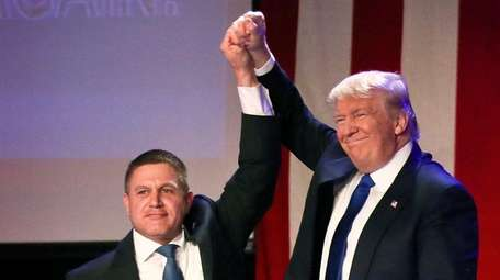 Republican presidential candidate Donald Trump, right, is introduced