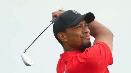 Tiger Woods of the United States hits his