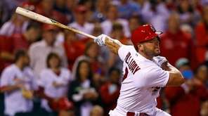 St. Louis Cardinals' Matt Holliday watches his home