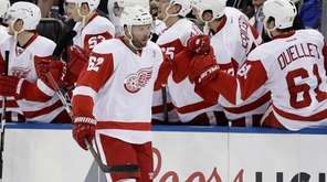 Detroit Red Wings' Thomas Vanek celebrates with teammates