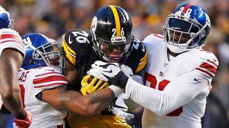 Pittsburgh Steelers running back Le'Veon Bell is tackled